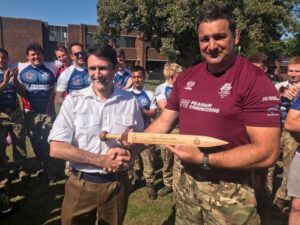 SSgt Ben Hughes being presented his Rudis in recognition of his work with the RE Field Gun Team